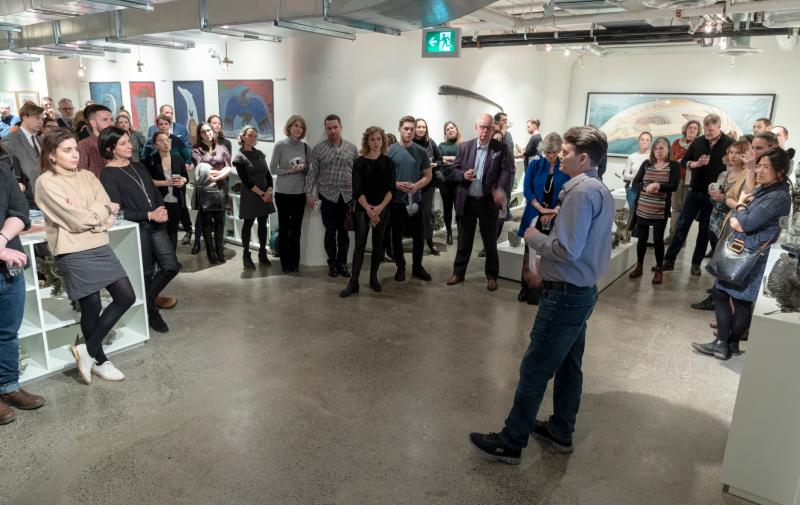 West Baffin Eskimo Cooperative General Manager    Jason Paul    welcomes more than 100 guests during the anniversary program announcement at the organization's Toronto offices.