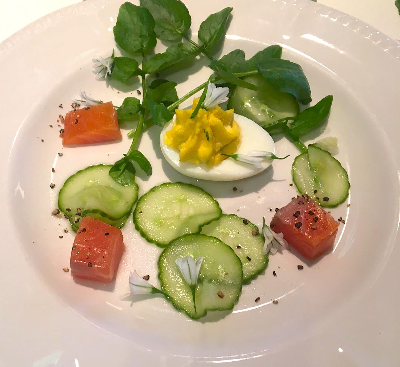 Devilled eggs with salmon scattered with wild garlic flowers