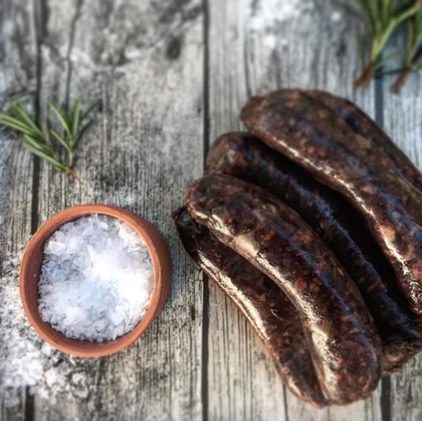 Feb 5, 2018 - Some of our tasty black pudding sausages. Unfortunately we couldn't keep our own blood due to abattoir restrictions but some well sourced powdered blood went into these to give us some sausages with a hint of black pudding. The colour of them is amazing - so dark and rich. It's funny that many of us will happily tuck into some black pudding along with a Full English breakfast without a second thought for the fact that they consist of blood. I've told a few people that in Italy I tried some of the raw blood from a freshly slaughtered pig. The family brought a bucket into their charcuterie and invited us to dip our fingers into the vivid red blood. I really wasn't so keen but I wanted to try it and see - so at least then I could have an opinion. It tasted like the most delicious fresh black pudding I've ever eaten. As ever, it's funny how differently we can react being presented a bucket full of blood compared to a compact piece of black pudding that's been shaped and fried up just to look like another piece of meat.