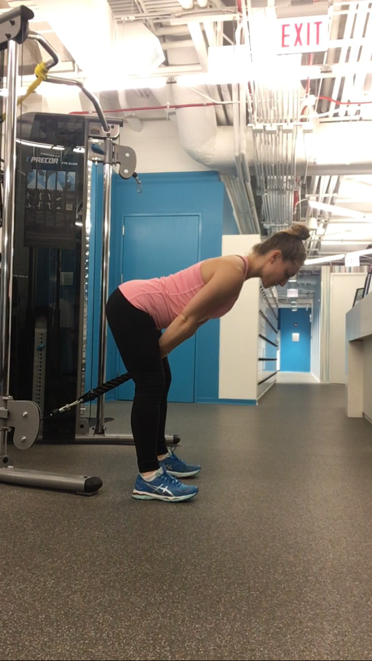Trainer Amanda doing cable pull throughs.