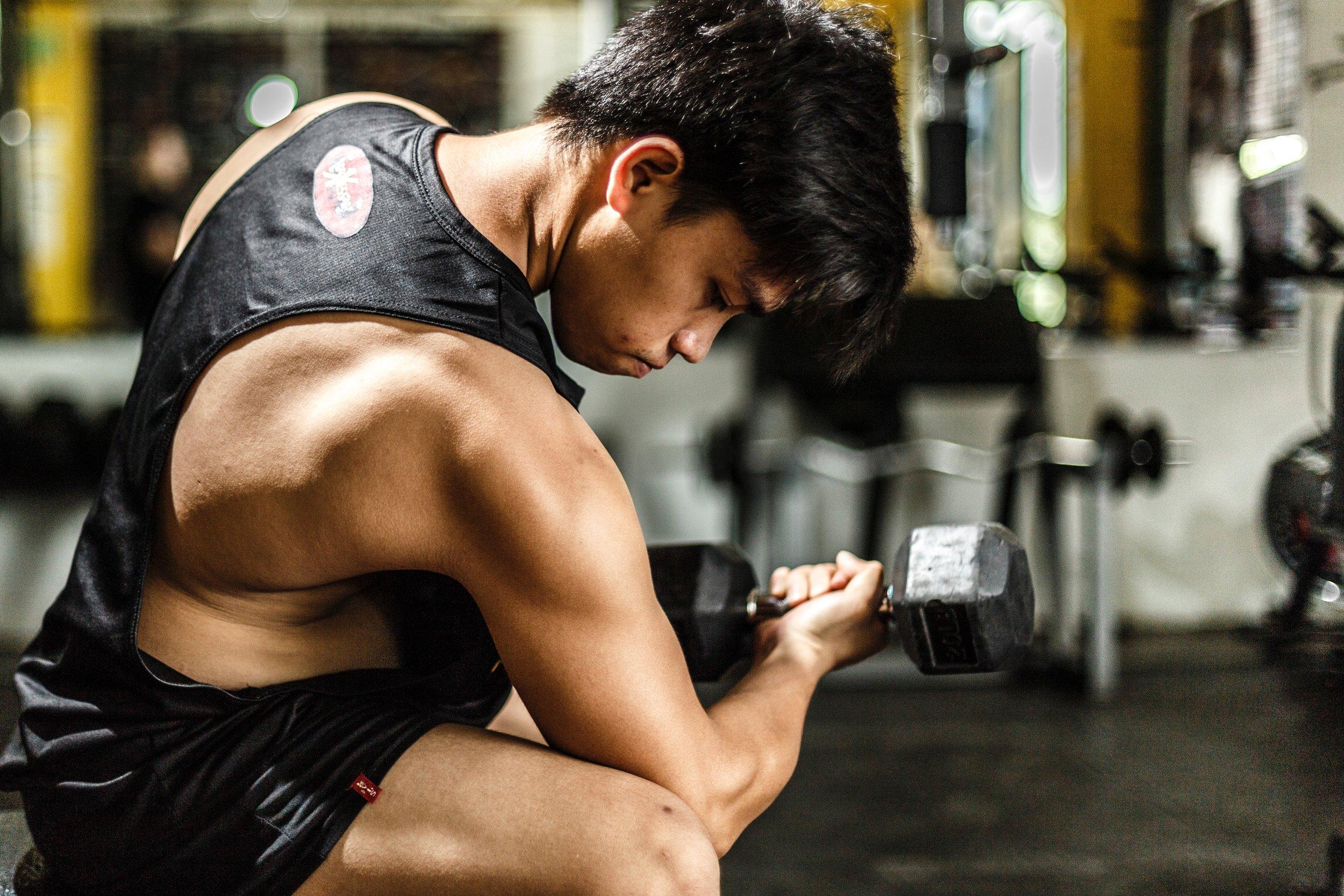 athlete-barbell-blurred-background-700446.jpg