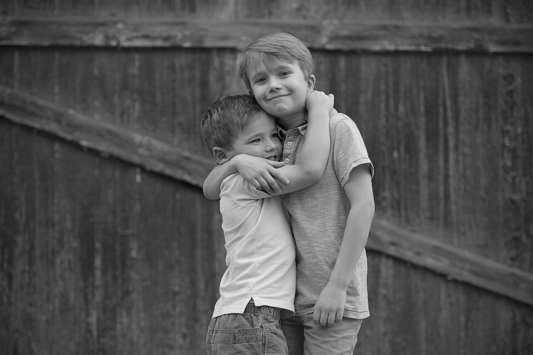 black and white of brothers hugging