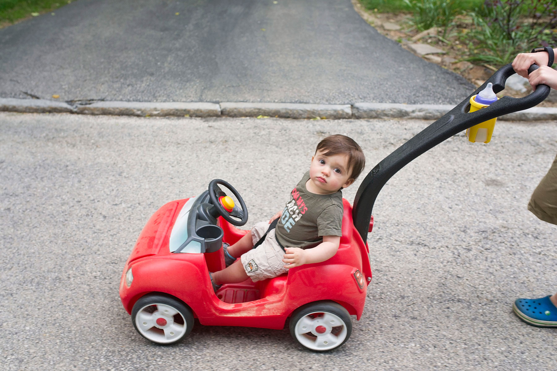 youngest brother gets pushed in red car by oldest brother