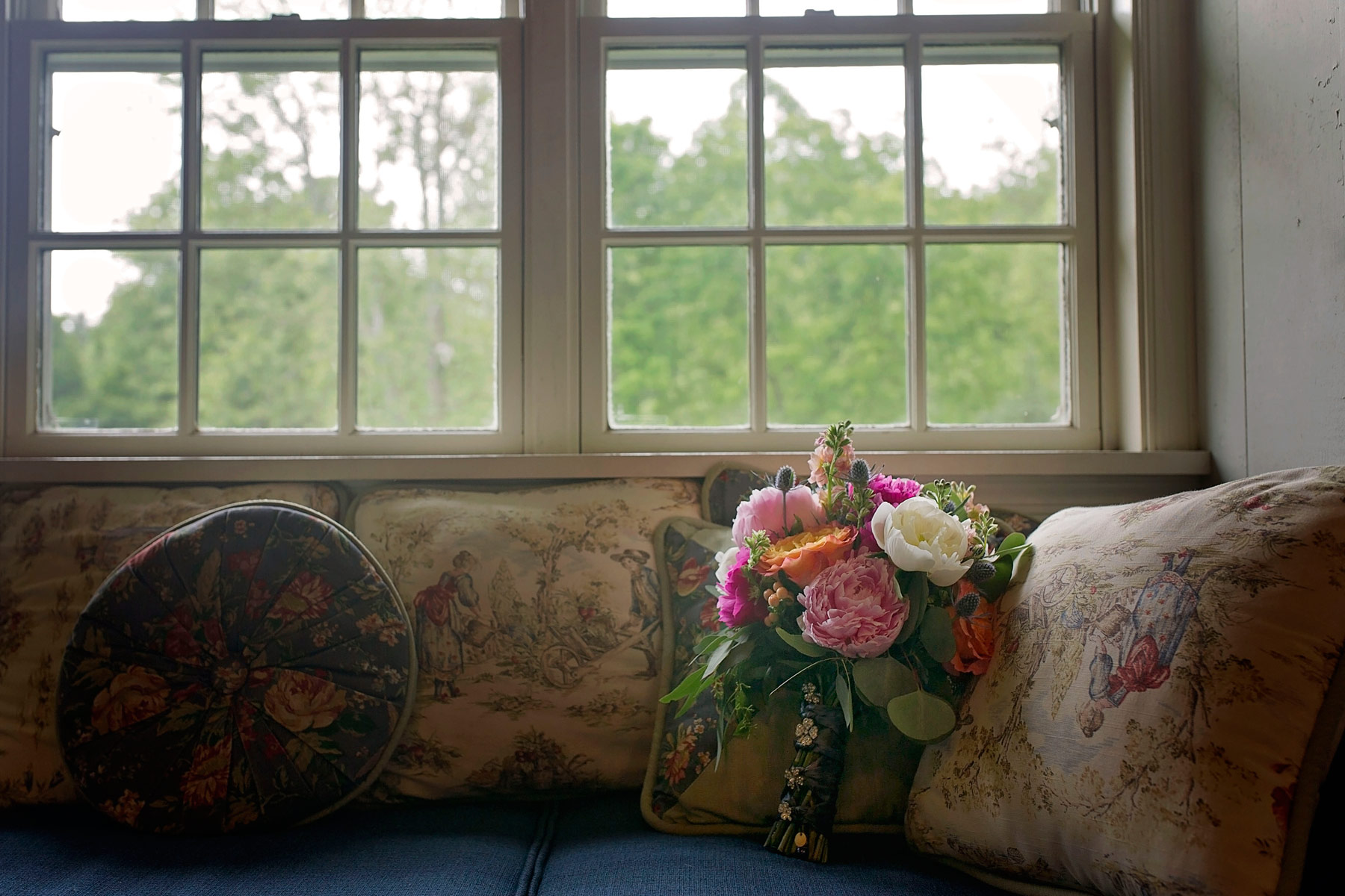 bridal bouquet on couch at the Woolverton Inn in New Hope