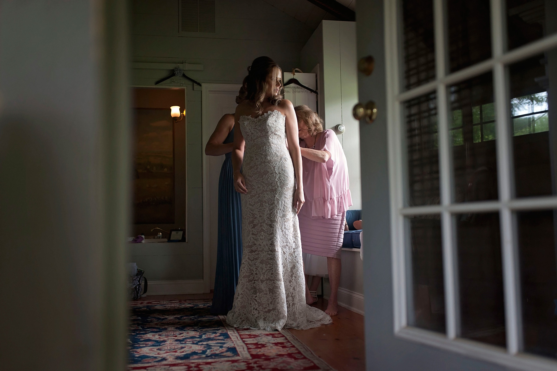 Bride gets dressed at the Woolverton Inn in Stockton, NJ
