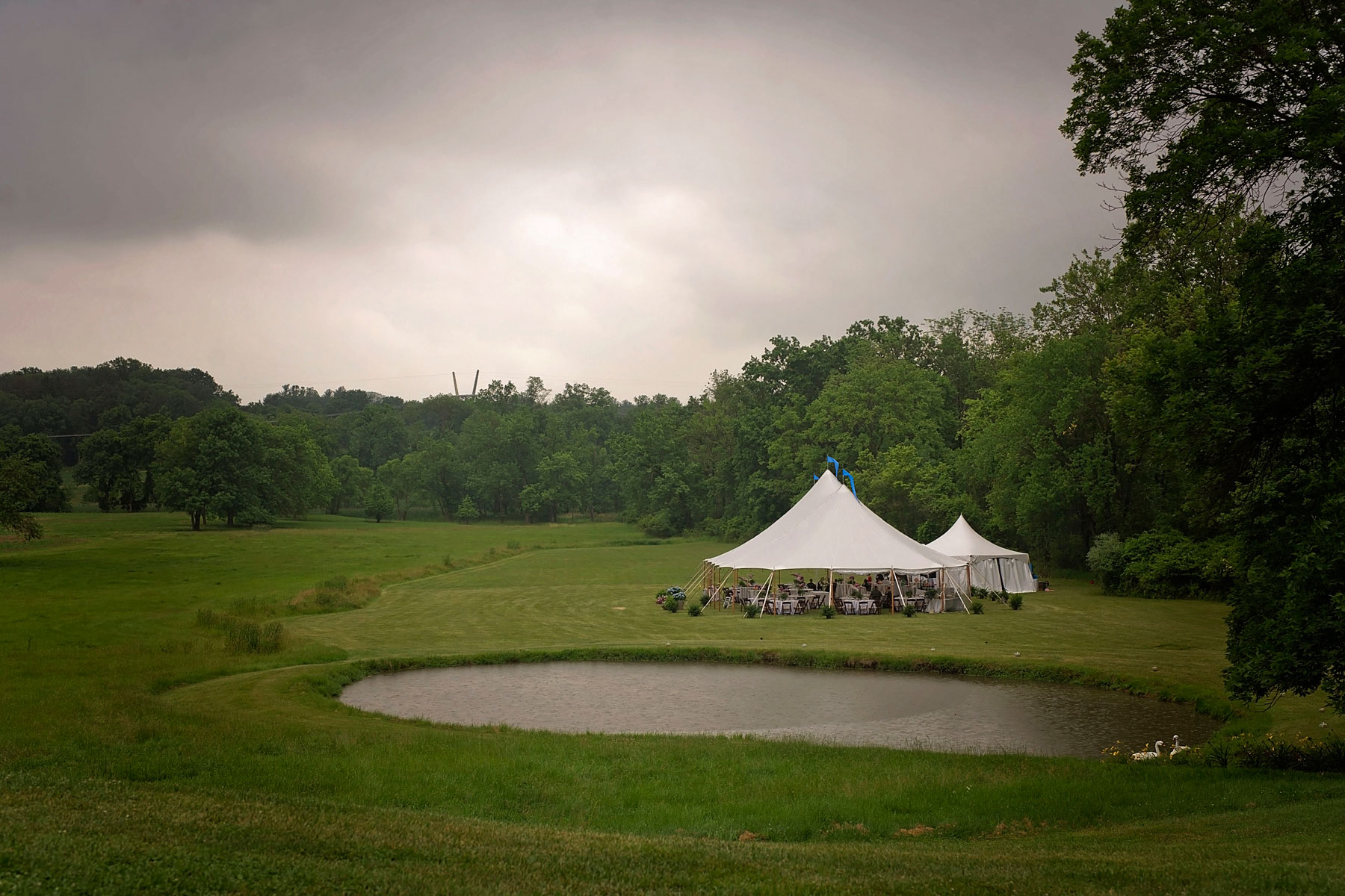 Property with sailcloth tent set up for a wedding with grey skies