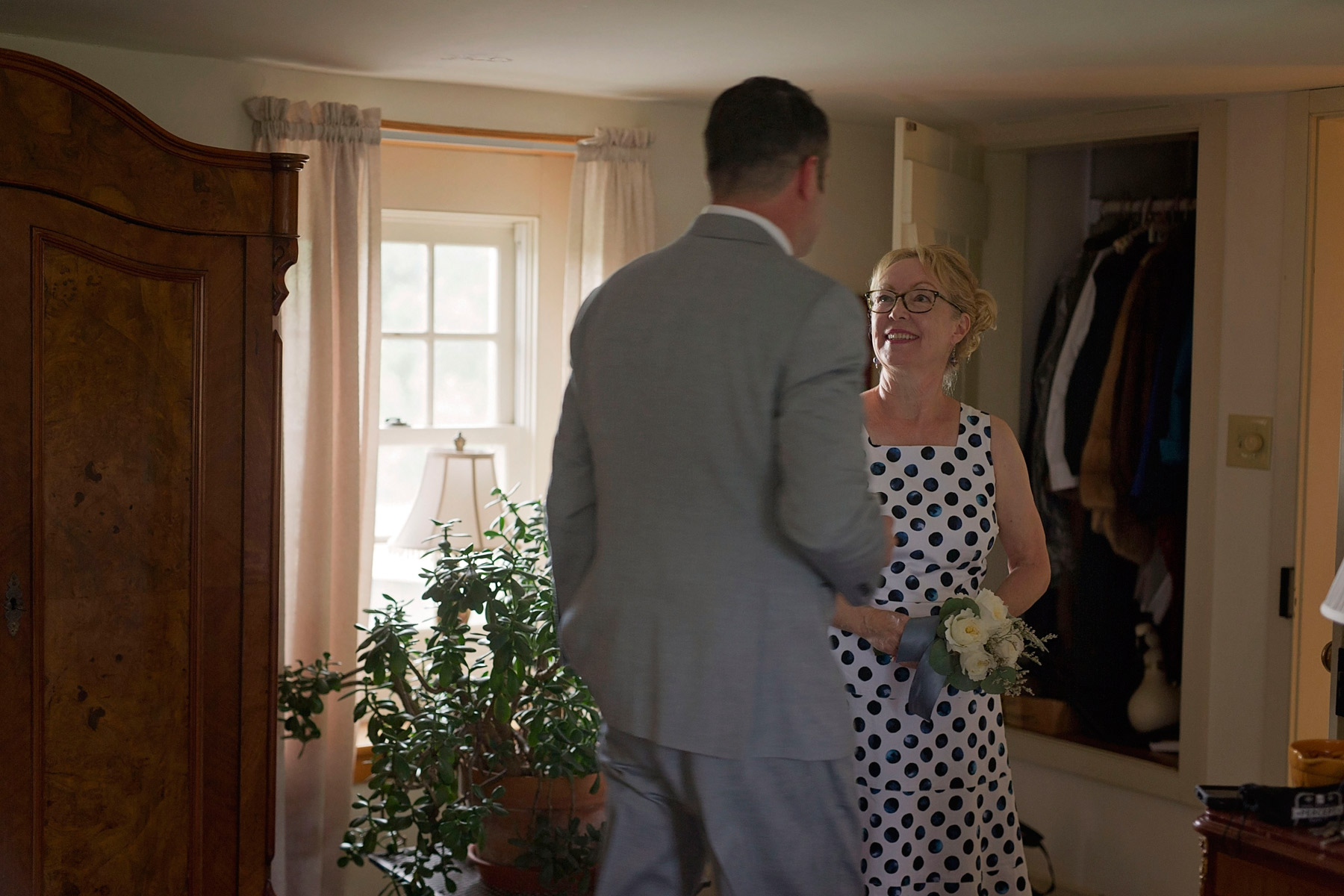 Groom and stepmother share a glance before wedding ceremony begins
