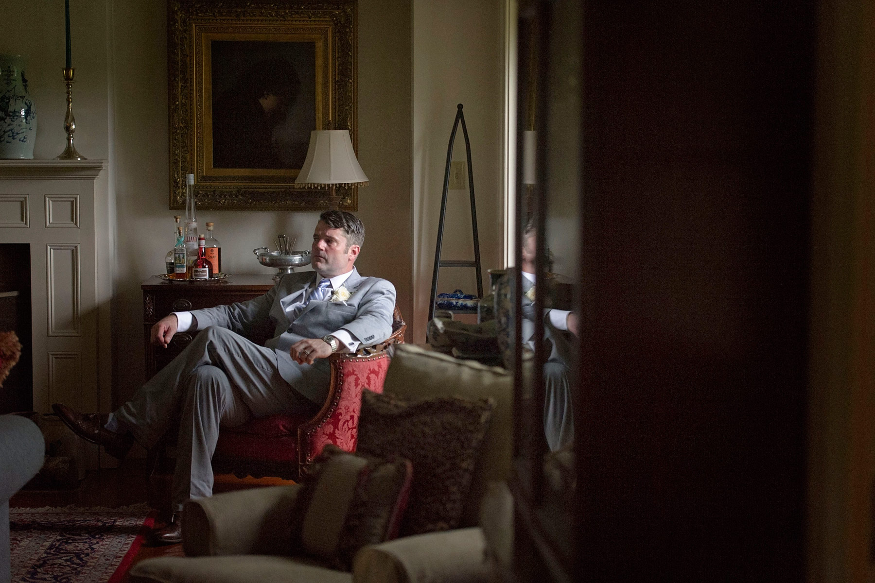 Groom relaxes in living room before the cermony