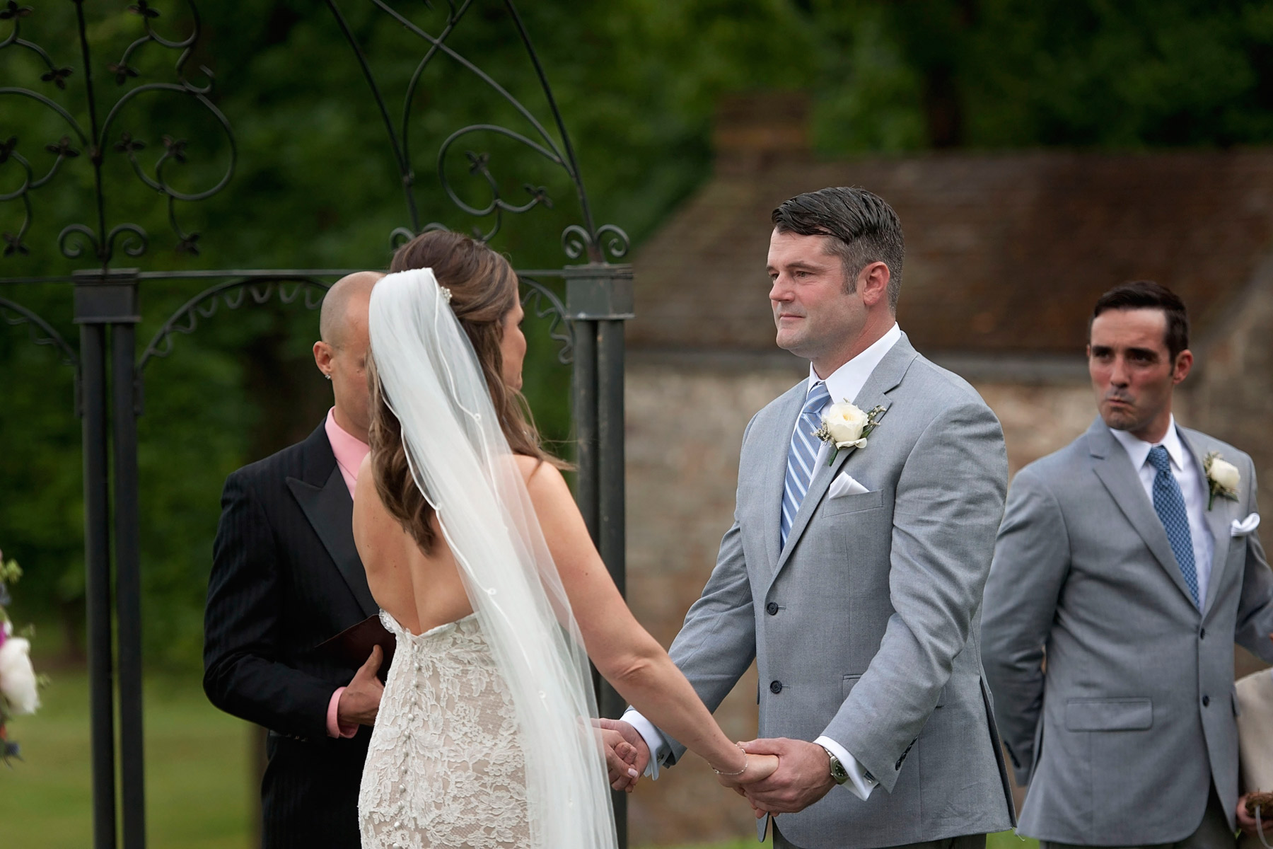 Bride and groom share wedding vows at outdoor cermony