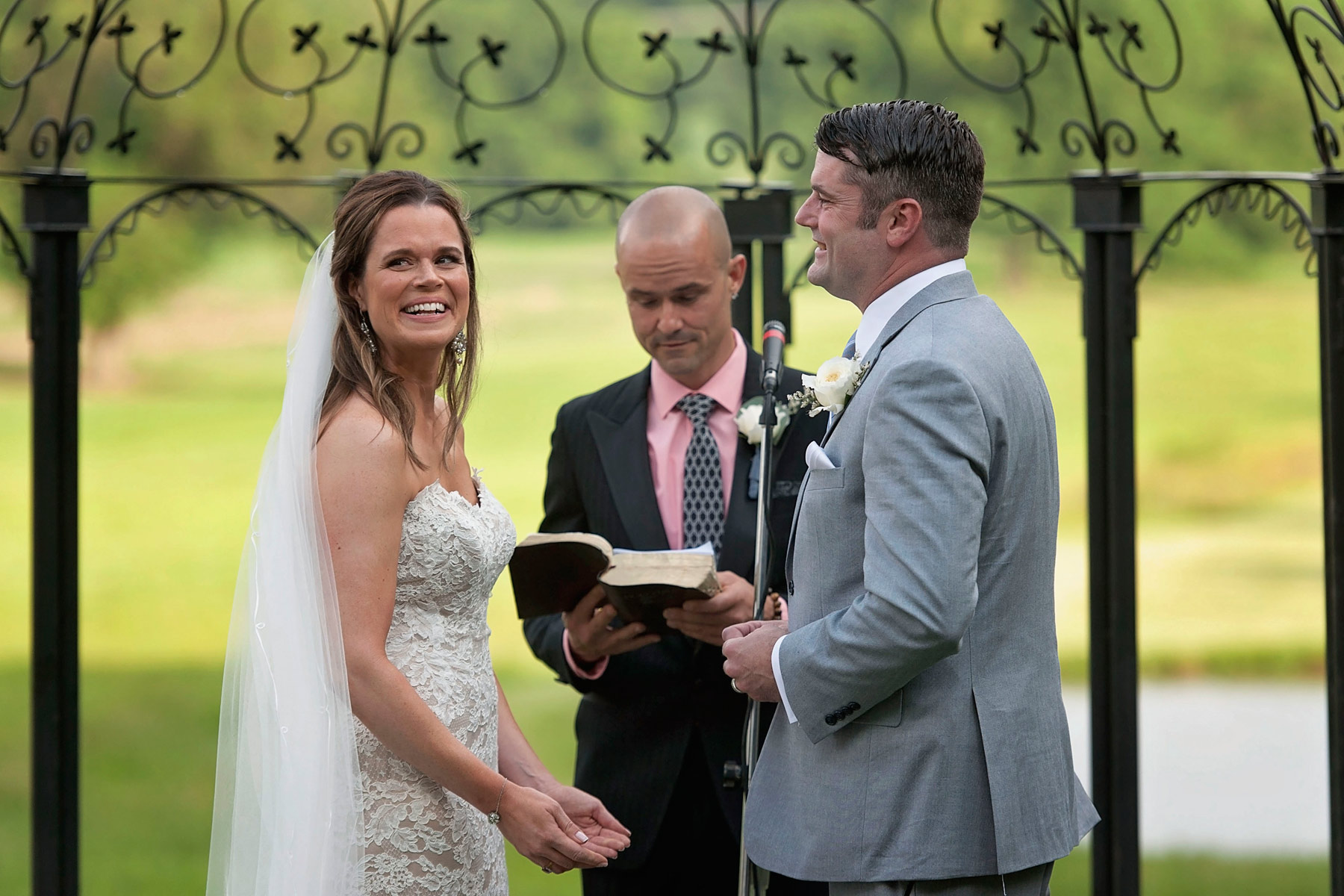 Bride laughs during wedding vow exchange