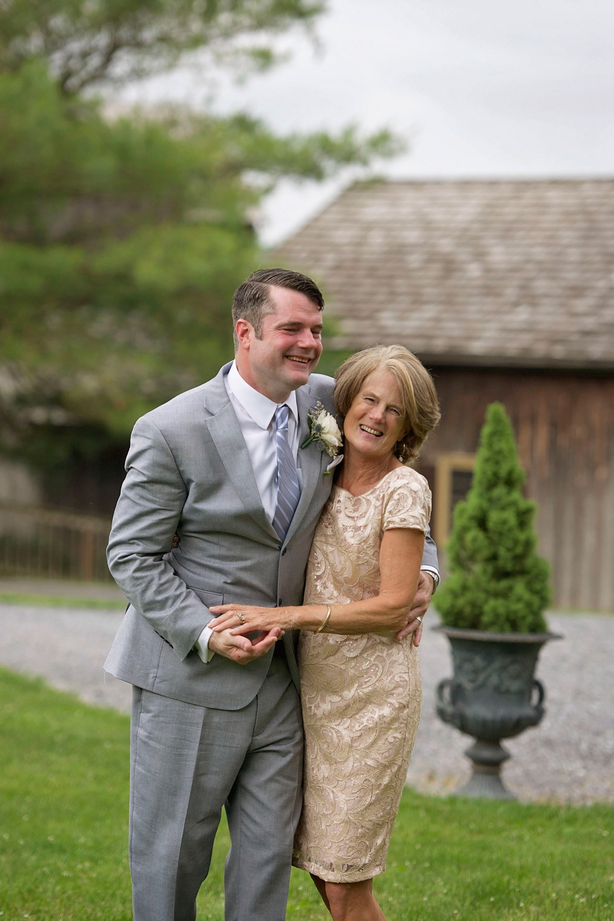 Groom shares a laugh with his mother