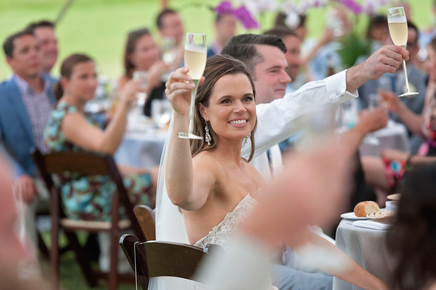 Newlyweds lift their glasses after wedding toast