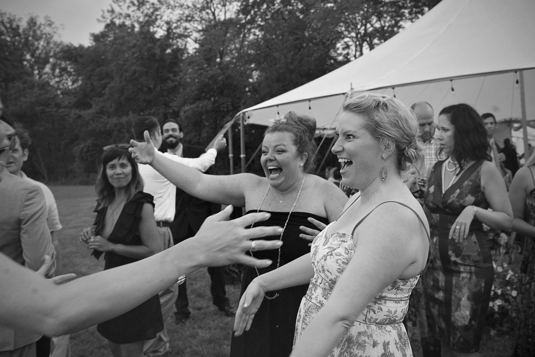 Friends greet the bride on her wedding day with enthusiasm
