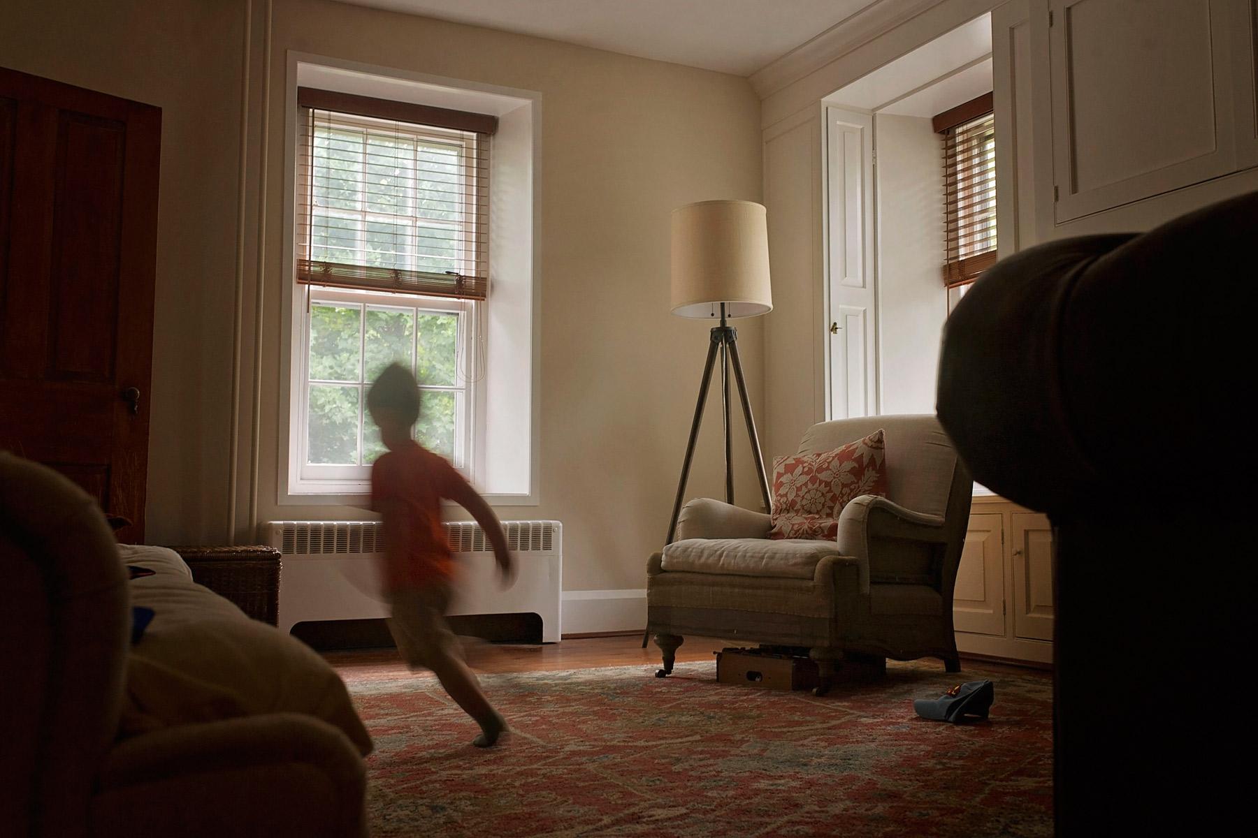 blur of boy running through living room