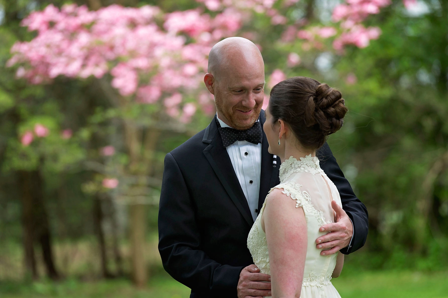 The groom smiles at seeing his bride for the first time