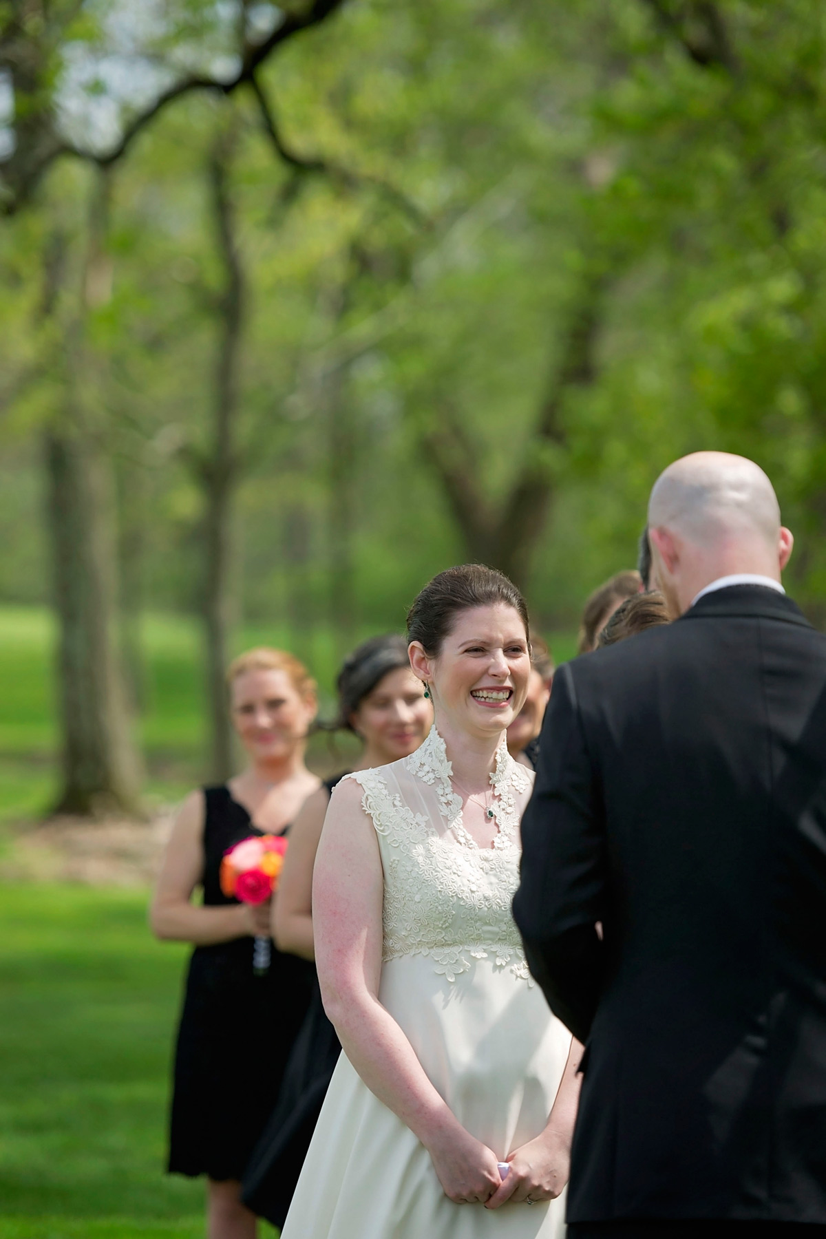bride laughs during wedding ceremony vows