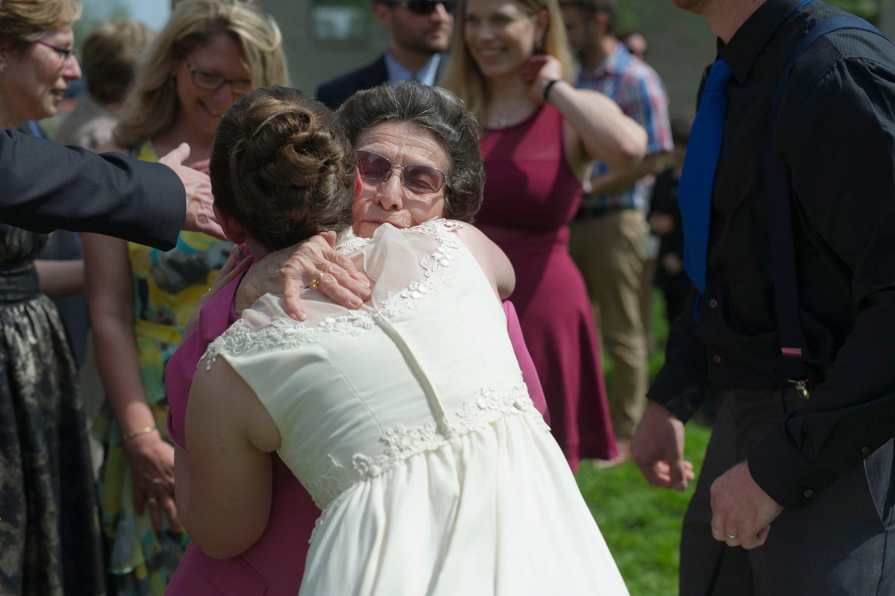 bride hugs grandmother in receiving line