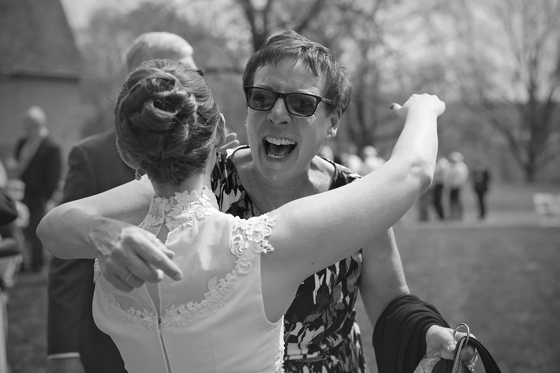 woman overjoyed to hug bride in receiving line
