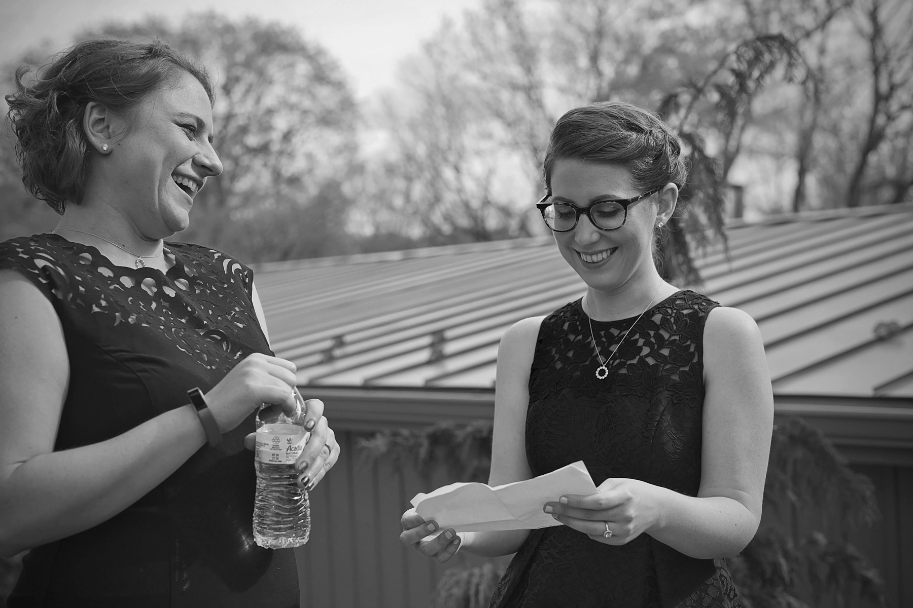 Maid of honor practices her toast with a bridesmaid