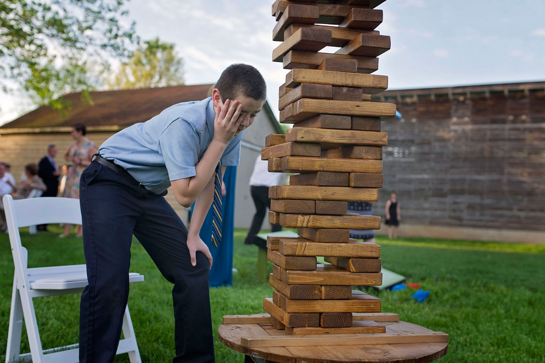 child shows concern while playing giant jenga