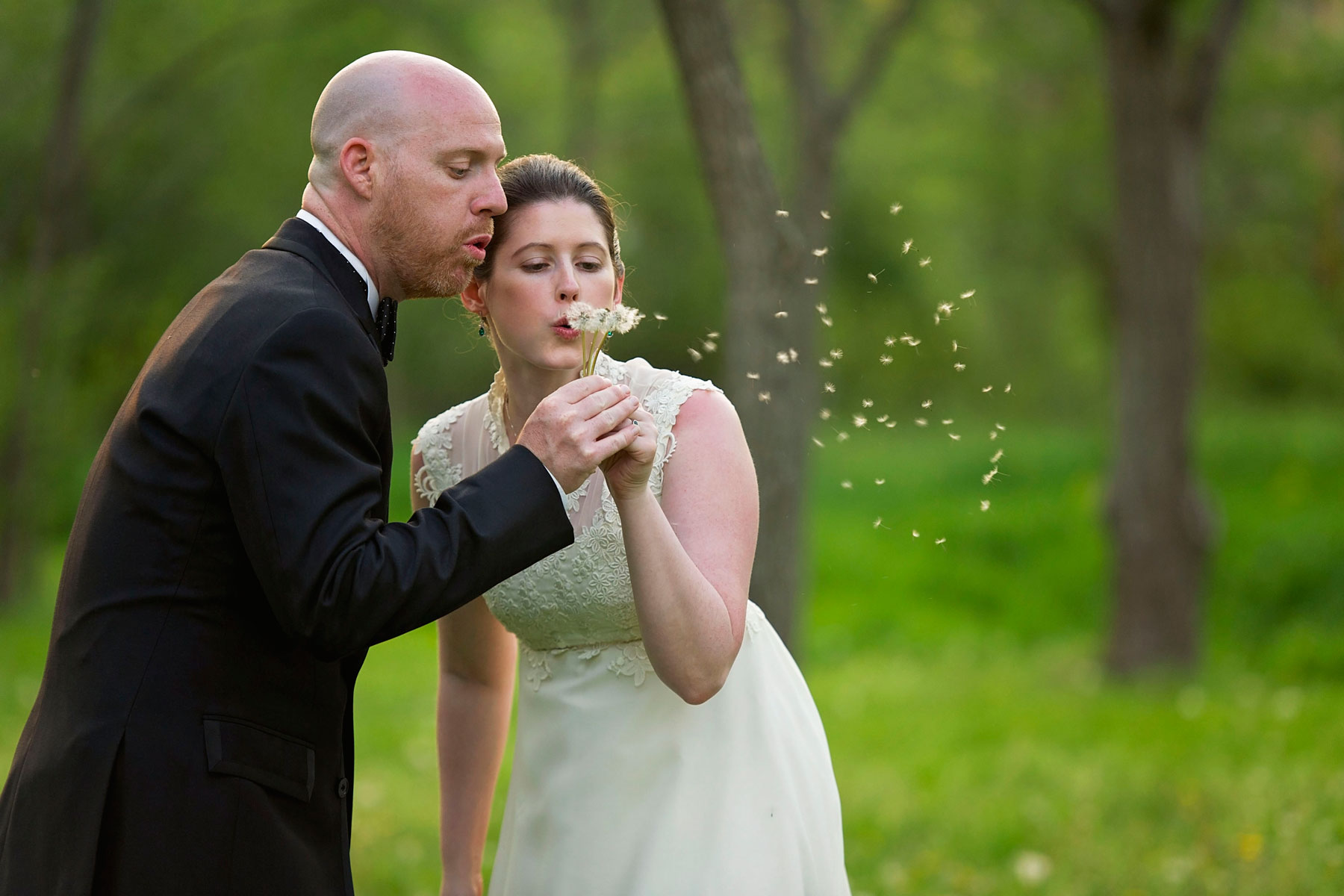 bride and groom make a wish together