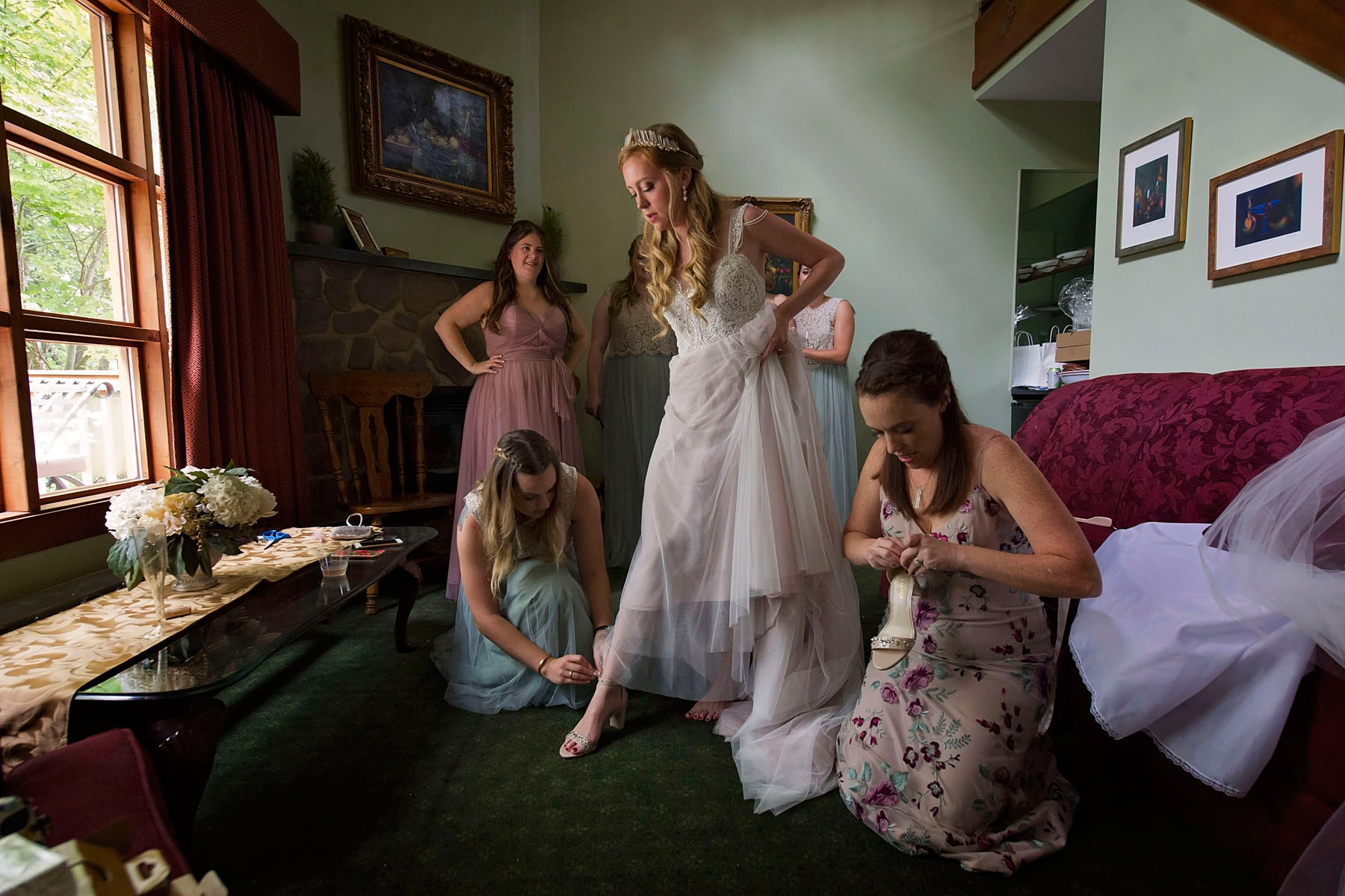 Bucks_County_wedding_photographer_Stroudsmoor_country_inn_wedding_Philadelphia_wedding_photographer_04_fairy_inspired_bride_getting_dressed_stepping_in_shoes.JPG