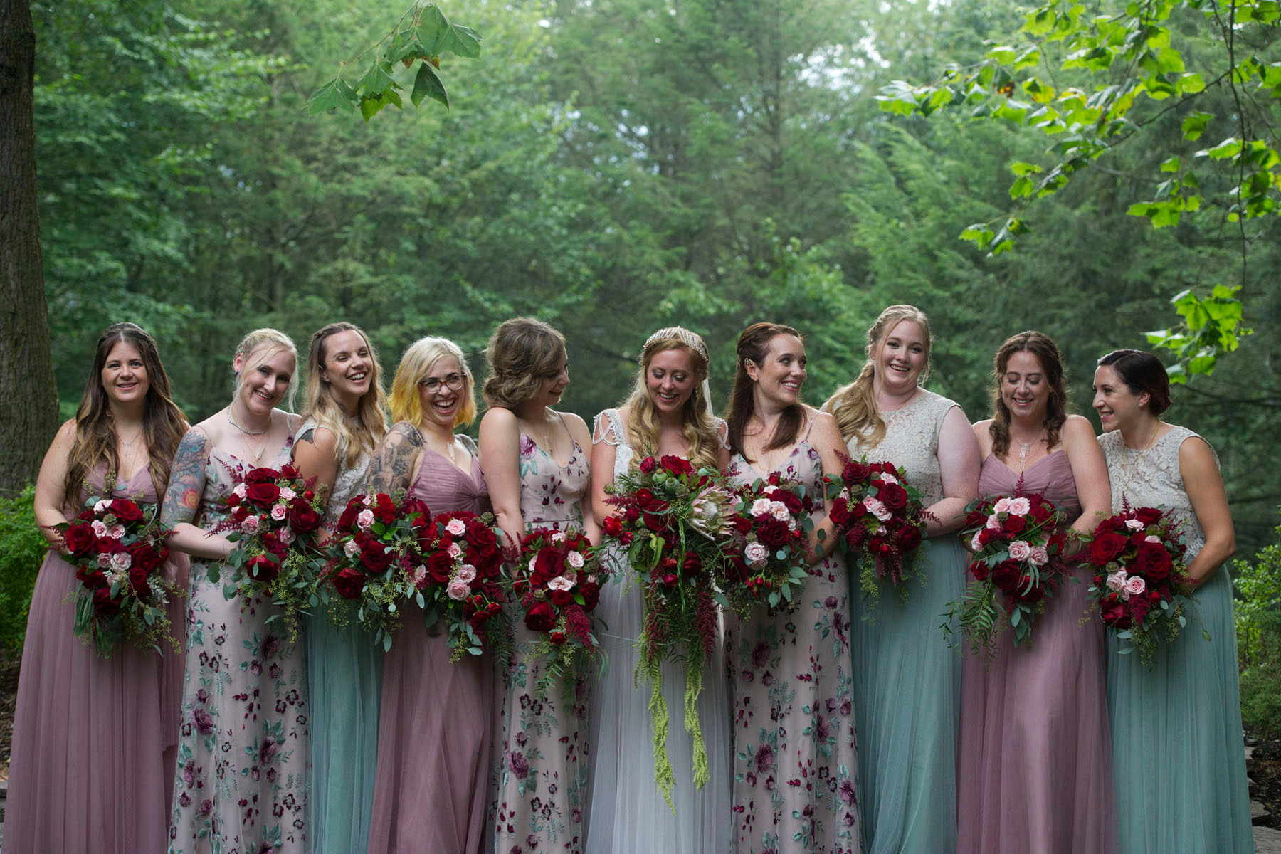 Bucks_County_wedding_photographer_Stroudsmoor_country_inn_wedding_Philadelphia_wedding_photographer_07_mismatched_bridesmaid_dresses_floral_bridesmaid_dress_pink_and_green.JPG