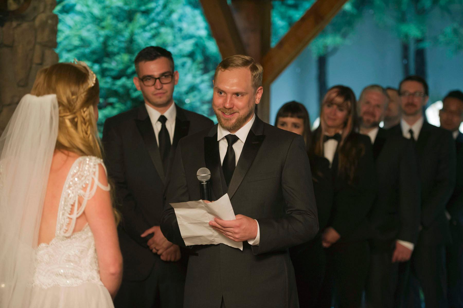 Bucks_County_wedding_photographer_Stroudsmoor_country_inn_wedding_Philadelphia_wedding_photographer_16_groom_reads_vows.JPG