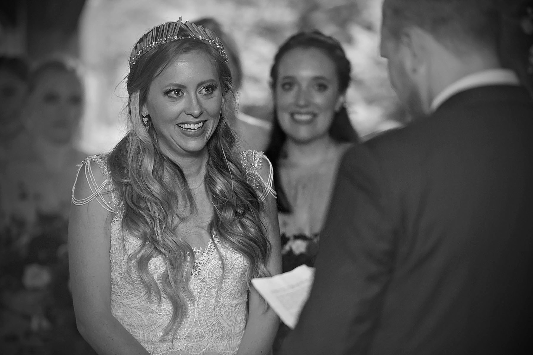 Bucks_County_wedding_photographer_Stroudsmoor_country_inn_wedding_Philadelphia_wedding_photographer_17_bride_laughs_at_grooms_vows.JPG