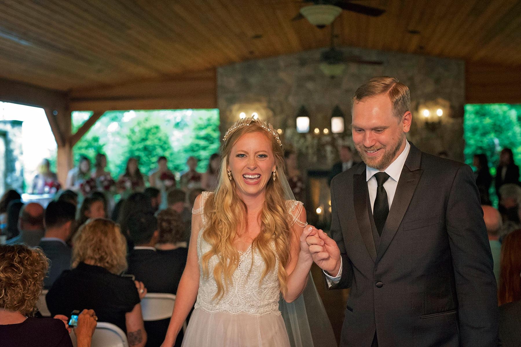 Bucks_County_wedding_photographer_Stroudsmoor_country_inn_wedding_Philadelphia_wedding_photographer_19_bride_and_groom_exit.JPG