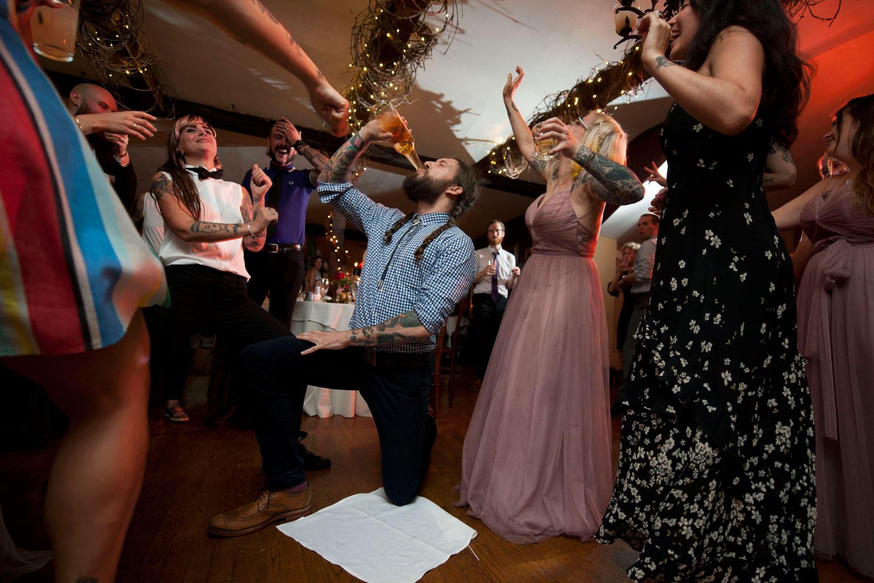 Bucks_County_wedding_photographer_Stroudsmoor_country_inn_wedding_Philadelphia_wedding_photographer_35_chug_on_the_dance_floor.JPG