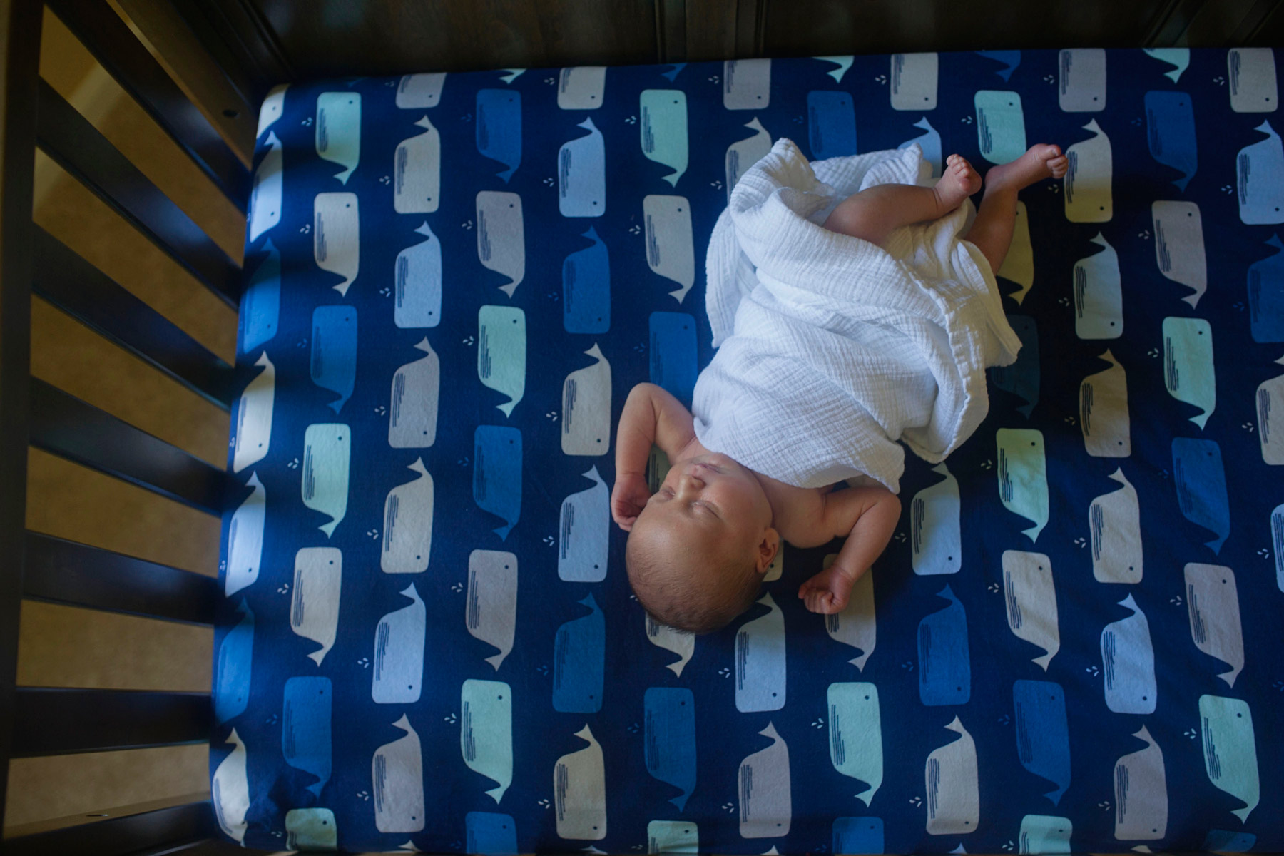 Main_Line_Newborn_photographer_Lifestyle_newborn_photographer03_baby_swaddled_in_crib.JPG