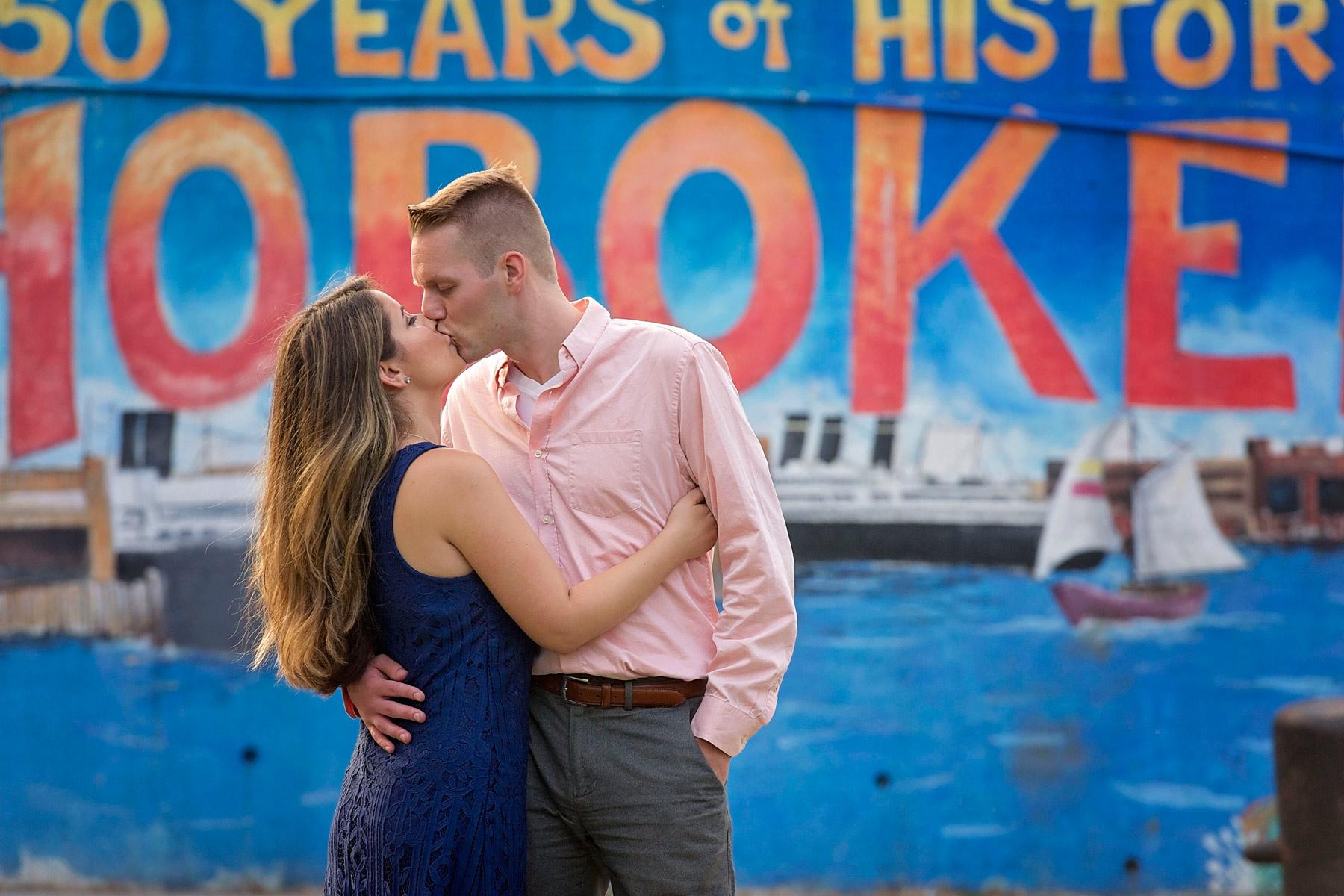 Hoboken_engagement_photographer_couple_kiss_in_front_of_Hoboken_billboard.JPG