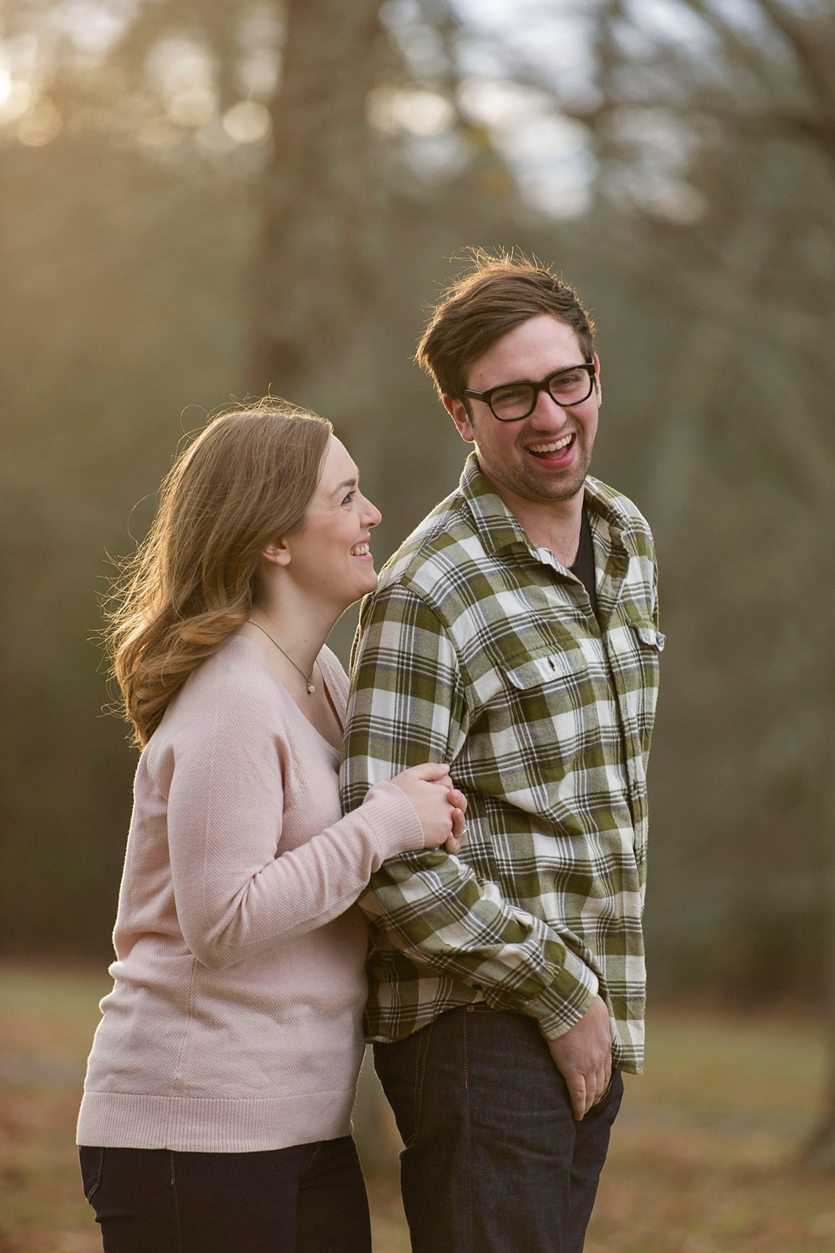 Bucks_county_engagement_session_Tinicum_Park_woman_makes_man_laugh.JPG