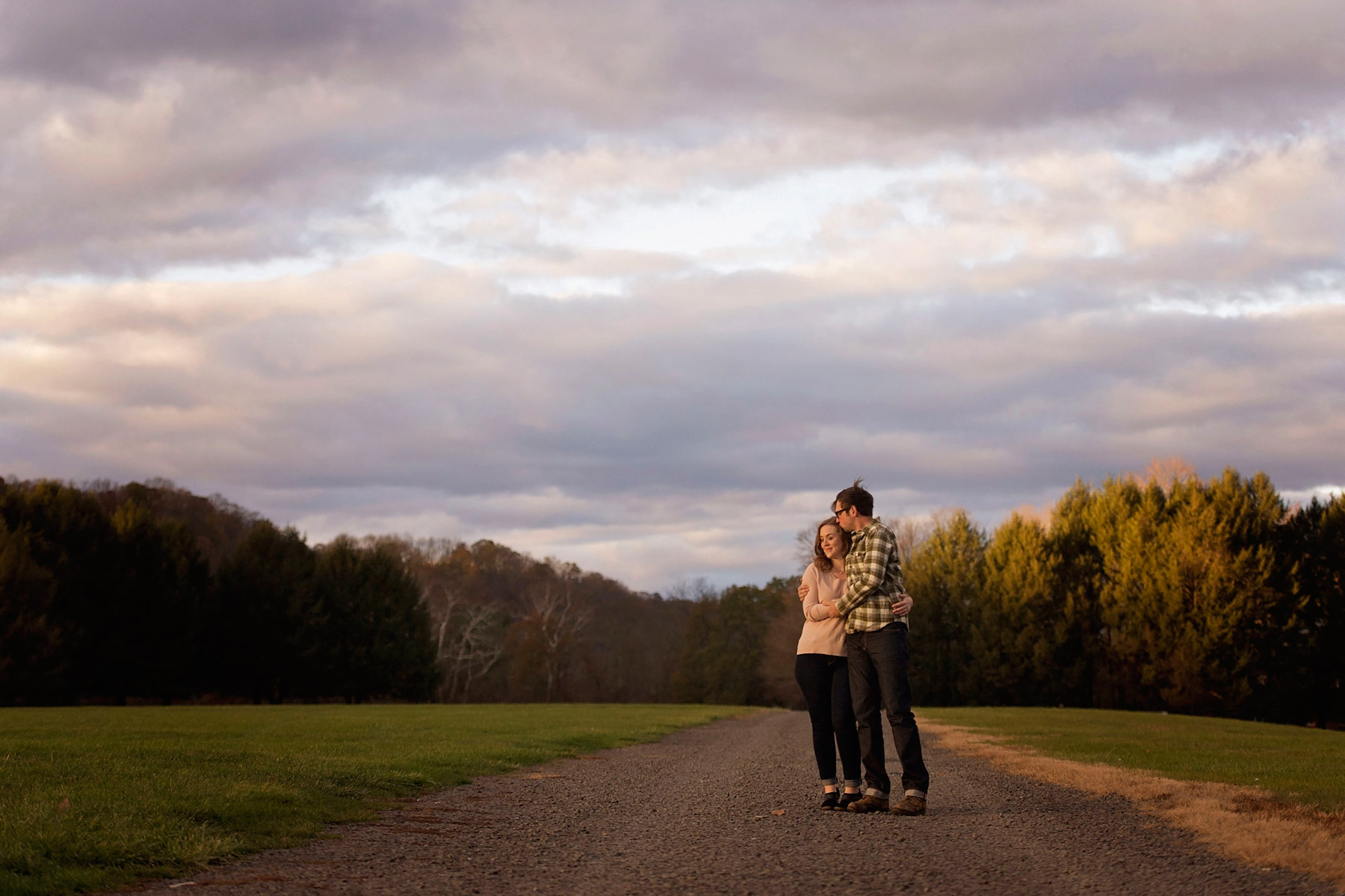 Bucks_county_engagement_session_Tinicum_Park_couple_standing_in_sunlight_on_path.JPG
