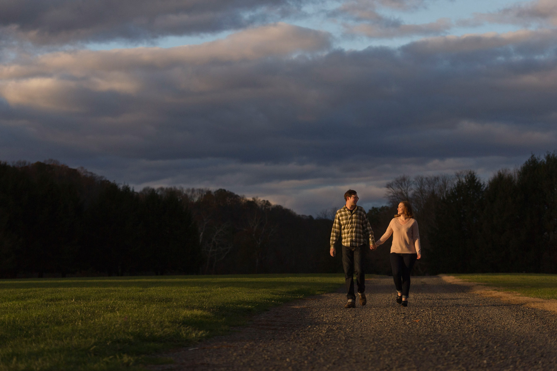 Bucks_county_engagement_session_Tinicum_Park_couple_walks_in_sunset_on_path.JPG