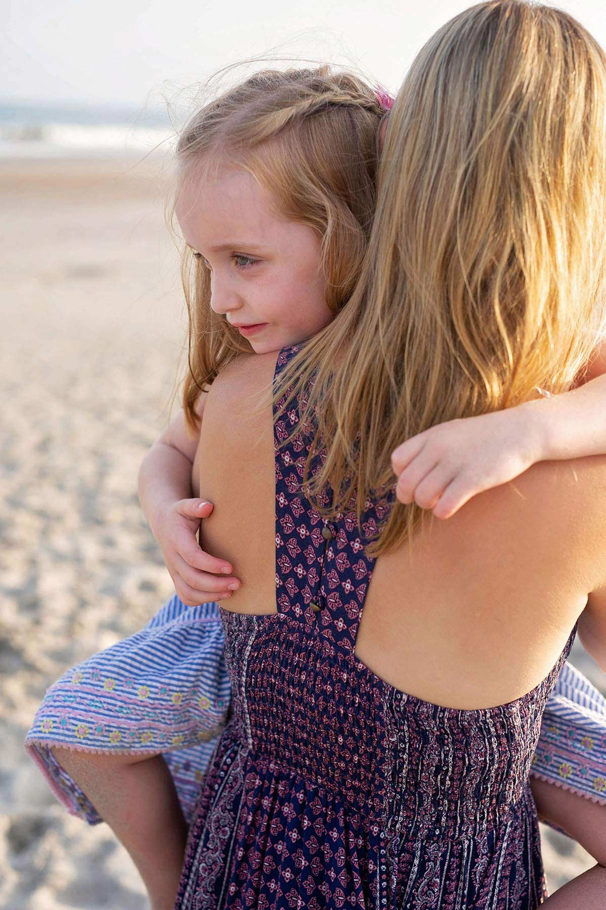 little_girl_clings_to_mother_on_beach_in_ocnj.jpg