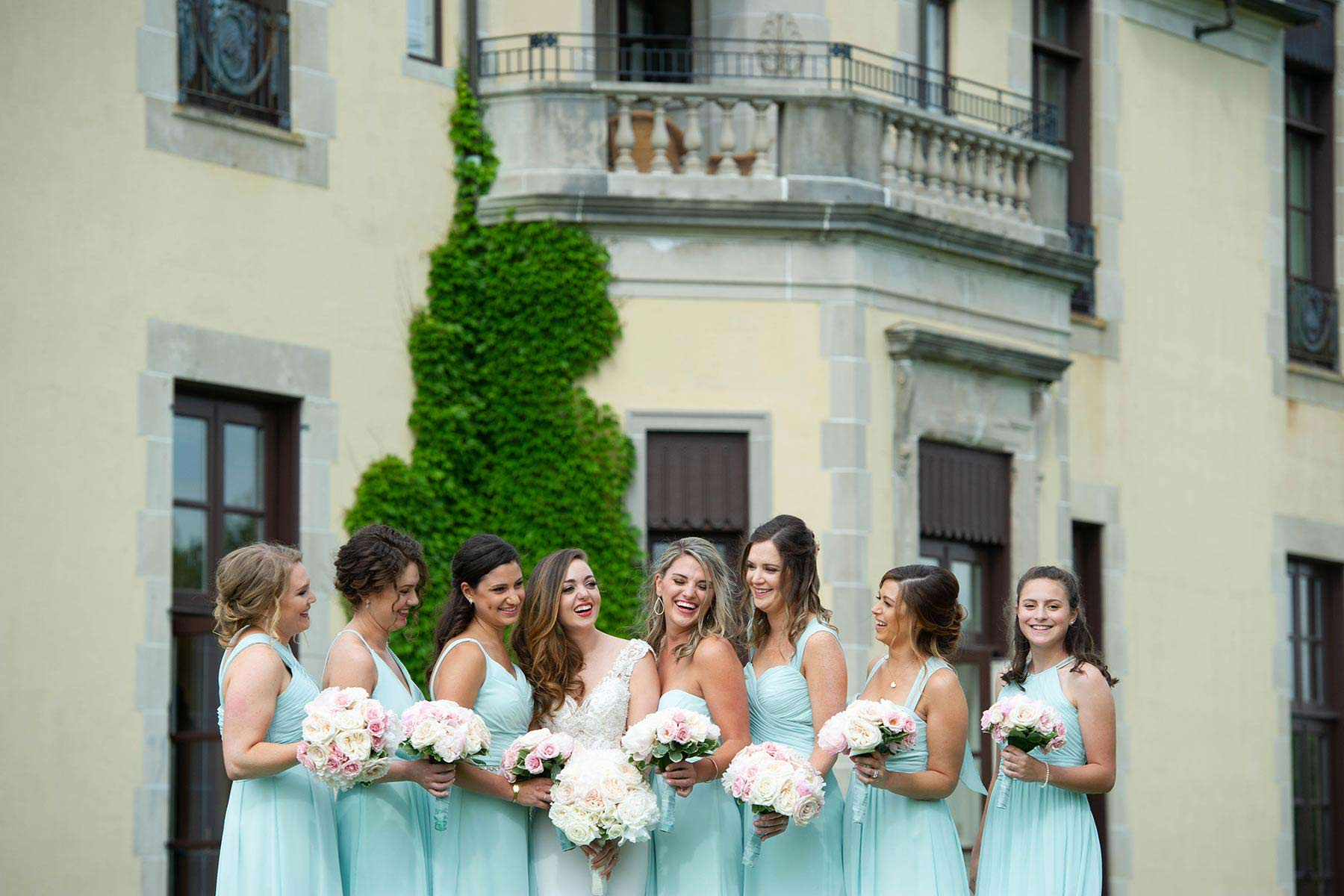 15_Bridesmaids_pose_outsie_Oheka_Castle.jpg