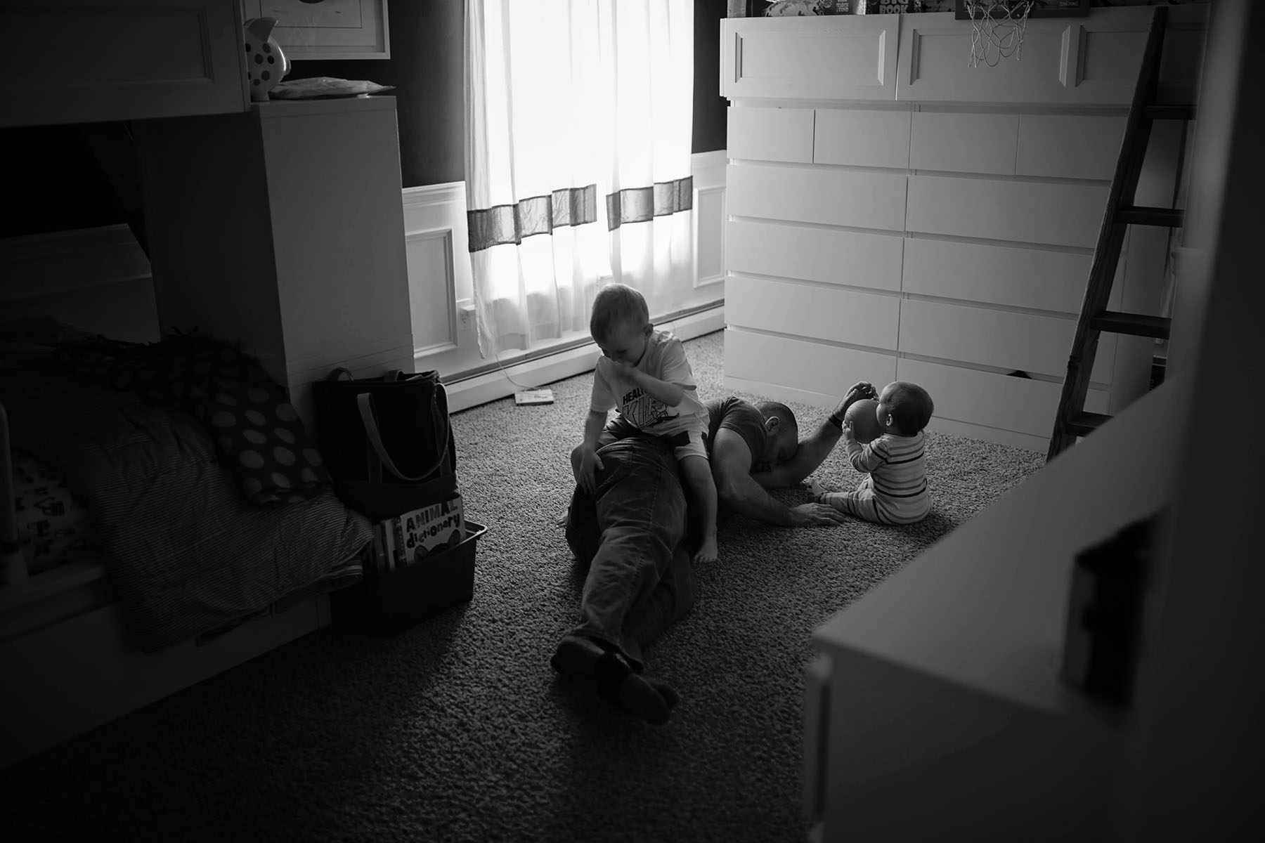 dad with two kids on the floor on Saturday morning