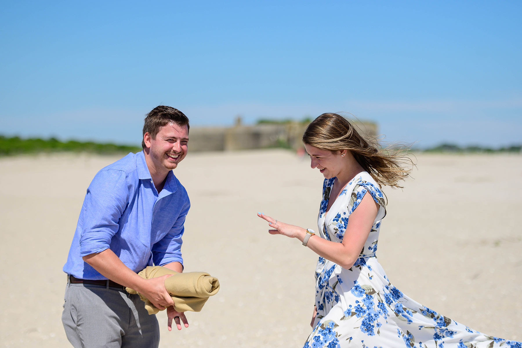 young couple gets engaged on the beach in cape may
