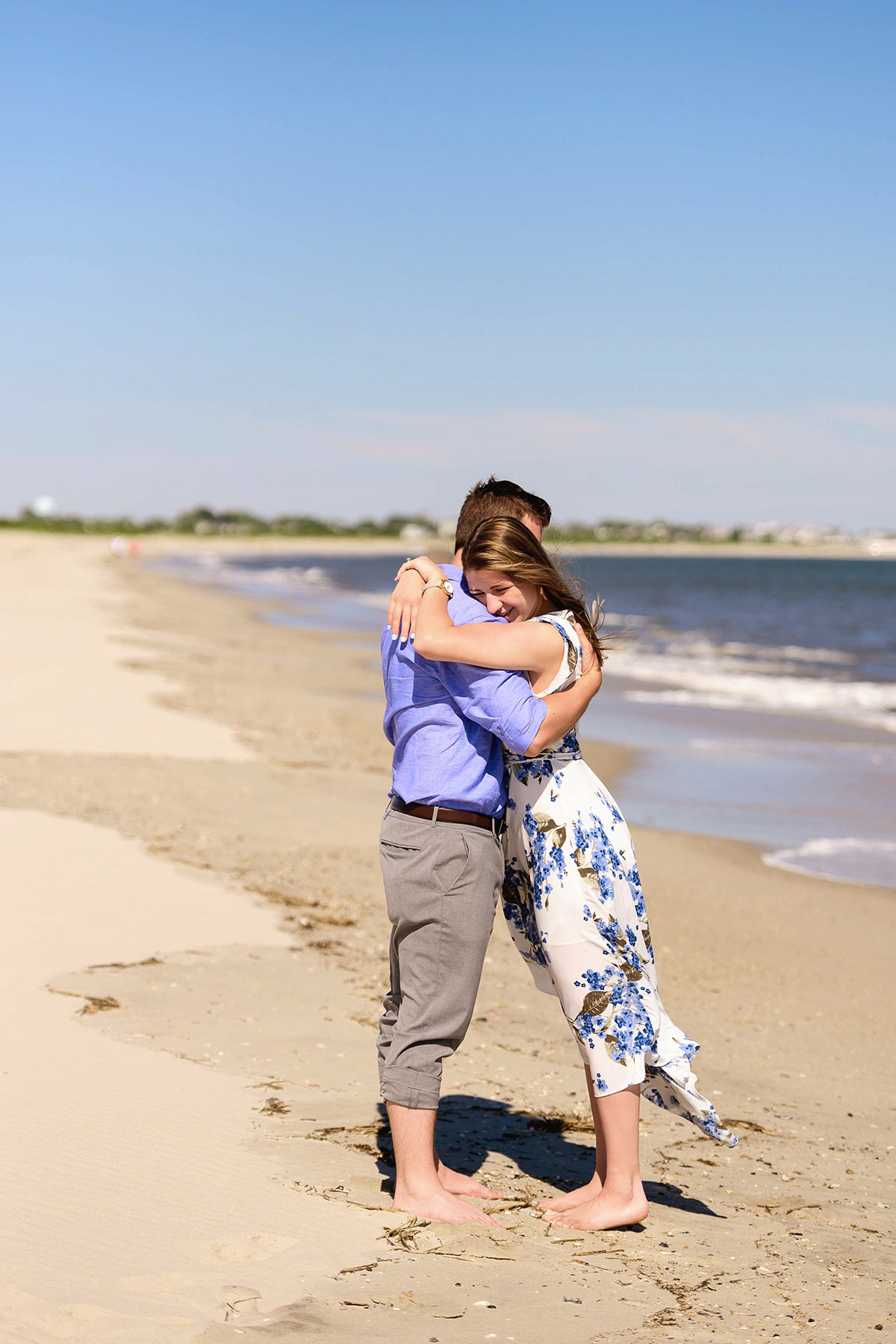 couple in embrace on the cape may shore
