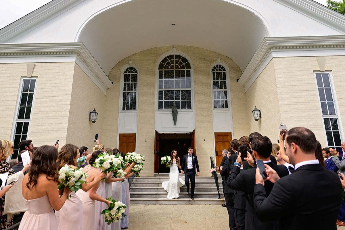 The couples makes their exit out of the church.