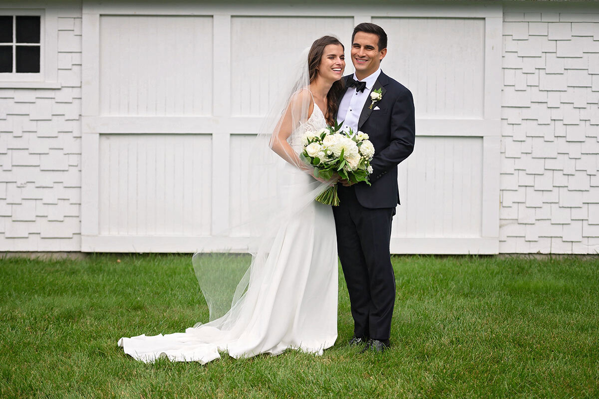 Bride and groom pose at Jonathan Edwards Winery