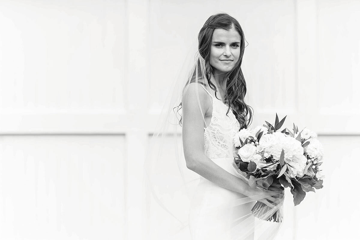 Black and white of bride on her wedding day.