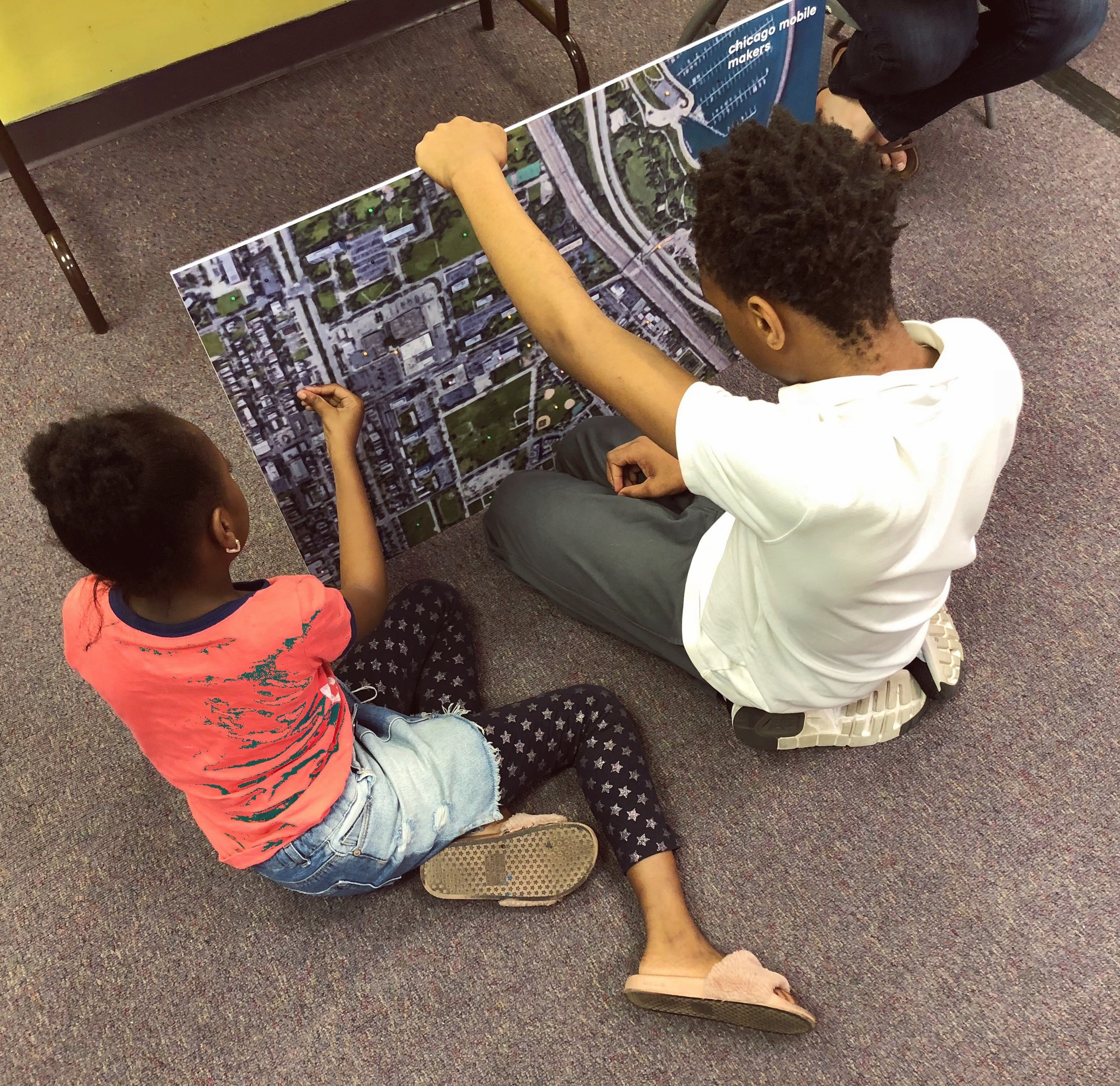 Students get a closer look at the map of their neighborhood.