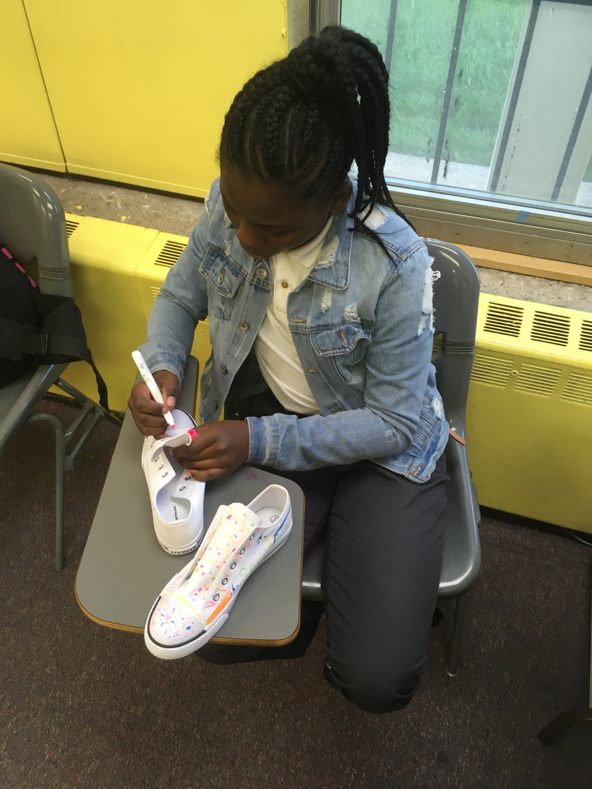 San'dexcia transfers her shoe concept onto her real shoes.