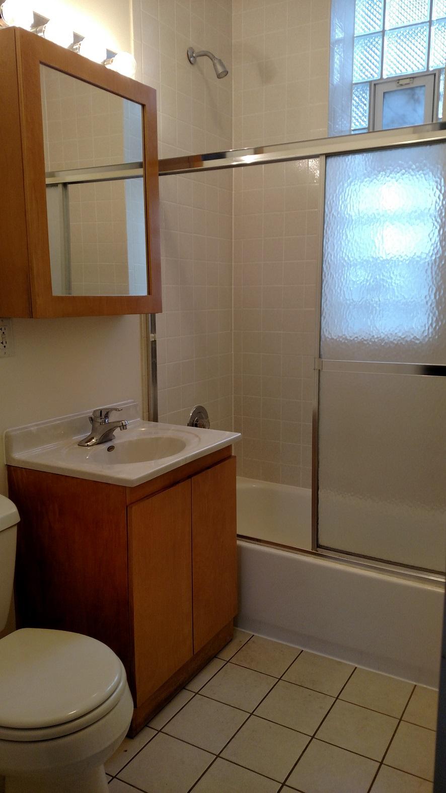 #1R bath - new floor tile and vanity top.jpg