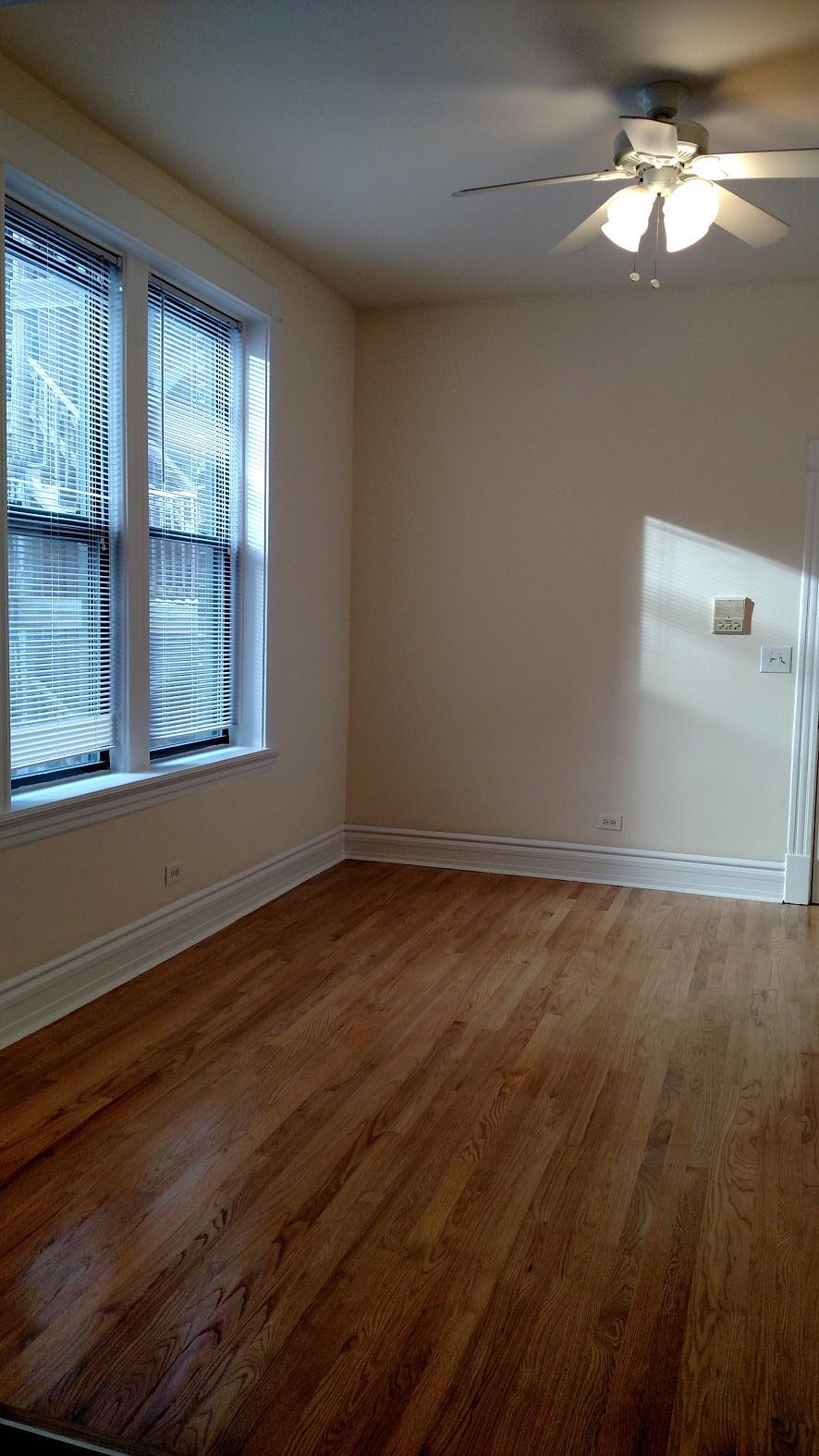 #1R lv rm with new wood floors.jpg
