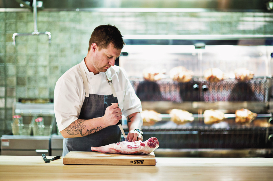 voltaggio-prepping-for-his-meatcentric-menu-while-chickens-take-a-spin-in-the-rotisol-rostisserie.png