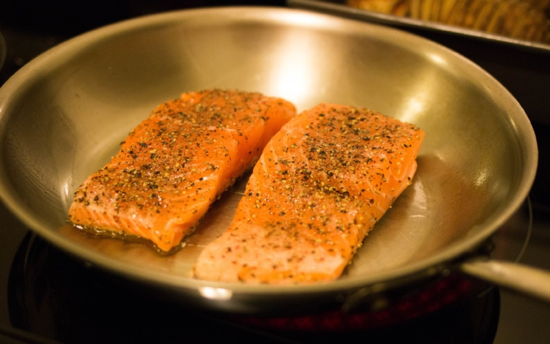 Pan-fried salmon seasoned with sea salt and freshly ground pepper, cooked over a generous coating of olive oil. Cooked high on both sides. A smoke-filled apartment was the only downside to this cooking method!